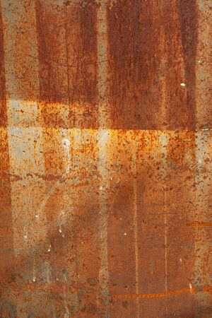 vertical image: Background vertical image as a steel sheet coated with rust