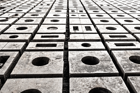 mounting holes: Blackandwhite image of mounting plates on the shop floor