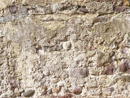 Background image of a wall of old stonework under a layer of plaster