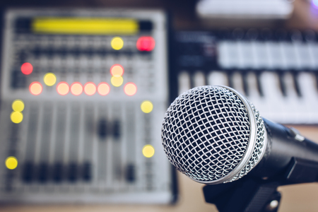 voices: dynamic microphone on digital studio mixer background for music recording, radio  tv broadcasting concept
