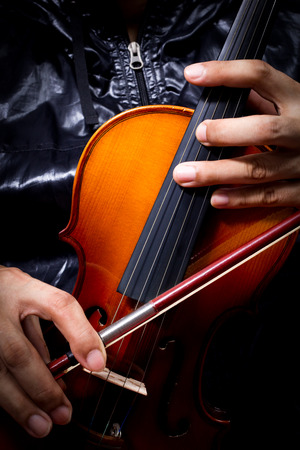 musical score: hands of musician in black jacket playing classical violin