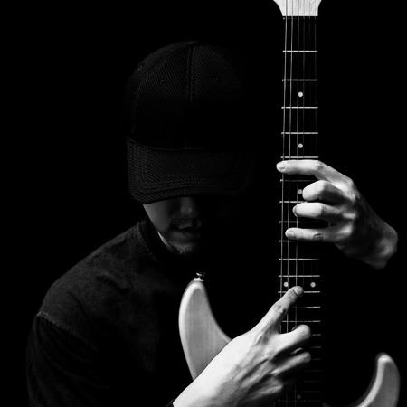 asian handsome musician posing on electric guitar. black and white
