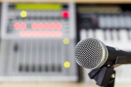 dynamic microphone on digital studio mixer background for music recording, radio, tv broadcasting concept
