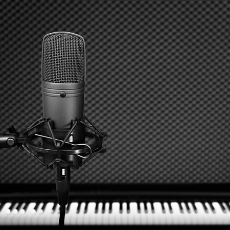 condenser microphone on piano background in recording studio