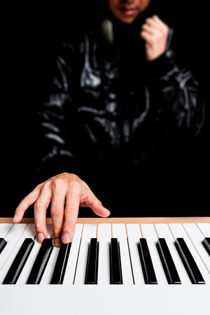 musician hands playing on piano keys Stock Photo