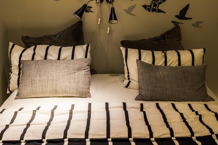 counterpane: cushion and pillow on bed, cozy bedroom