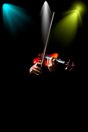 male musician hands playing classical violin in concert