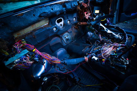 car repair & electric wiring system showing colorful wire in old car, interior view Foto de archivo