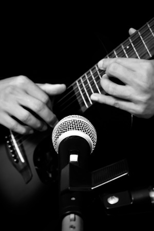 musician hands playing & recording acoustic guitar Stock Photo