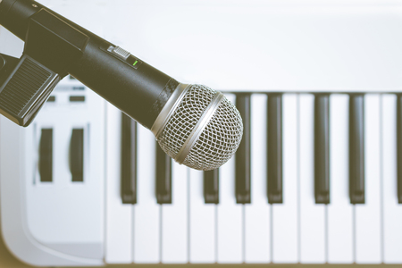 microphone on piano keys background