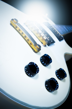 white electric guitar, isolated on black for music background Stock Photo