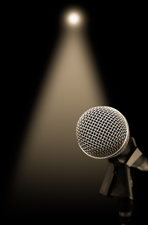 dynamic microphone on stage with spotlight for music background