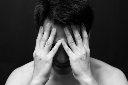 asian handsome man in black and white emotion portrait photo  feel sad ,headache and alone on dark background Stock Photo