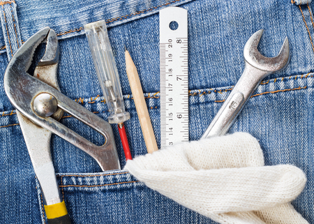 work tools in jeans pocket