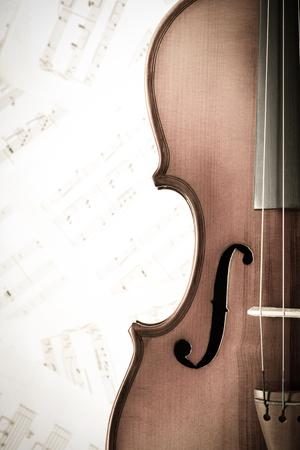 musical score: violin on music sheet, vintage filter