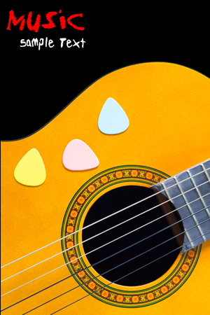 audio book: colorful picks with acoustic, classical guitar. isolated on black Stock Photo