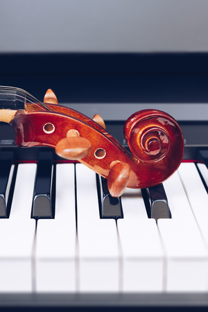 violin headstock on piano keys, music background