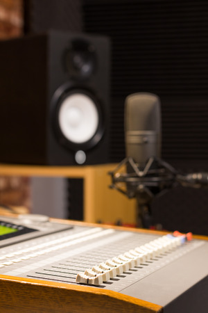 sound mixer, condenser microphone & speakers in recording music studio or radio broadcasting station Stock Photo