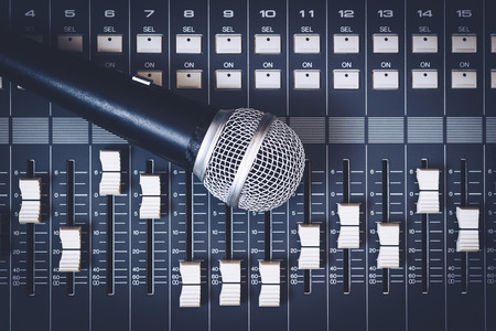 dynamic microphone on sound mixer, music background