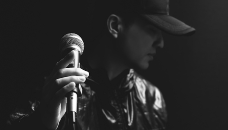 asian male singer hands on microphone, black and white Stock fotó