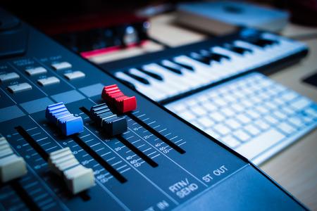 music production concept. sound mixer, midi keys, audio interface & computer keyboard