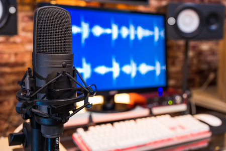 condenser microphone in digital recording, broadcasting studio background