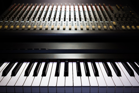 piano and sound mixer in recording studio, music background