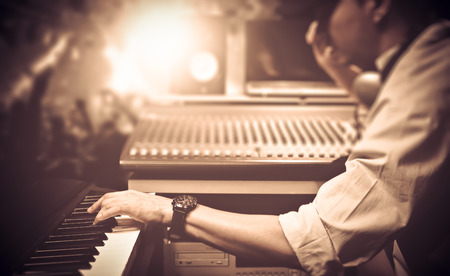 male DJ, musician playing midi keyboard synthesizer in nightclub, concert. focus on hands Stock Photo