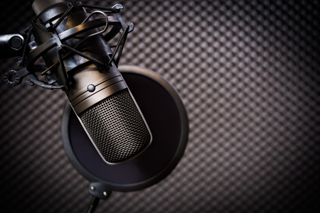 condenser microphone in recording studio, music background