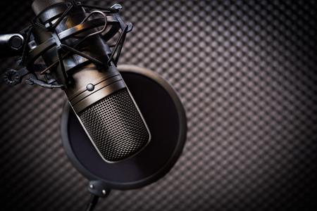 condenser microphone in recording studio, music background