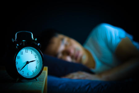 sleeping asian man in bed at night Stockfoto