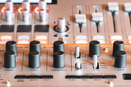 recording equipment knobs, buttons, fader