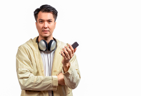 asian handsome man use smartphone for listening music, isolated on white