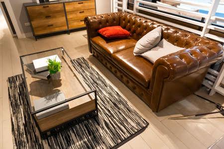 brown elegant leather sofa in living room Banco de Imagens