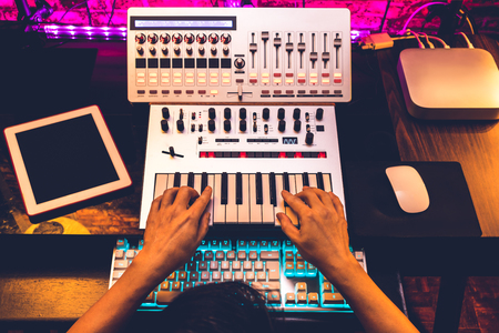 producer hands arranging and mixing music in home studio Imagens