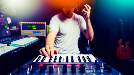 asian male music producer, dj making electronic dance music in sound studio Imagens
