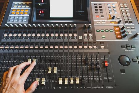 sound engineer, producer, dj hands adjusting sound mixer fader Stock Photo