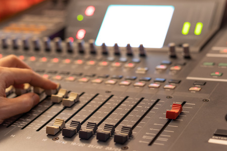 audio mixing console fader. recording, broadcasting, editing, post production concept