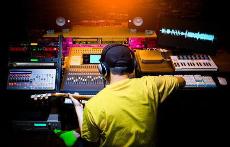 back of male asian musician recording guitar sound in home studio. music production concept Imagens