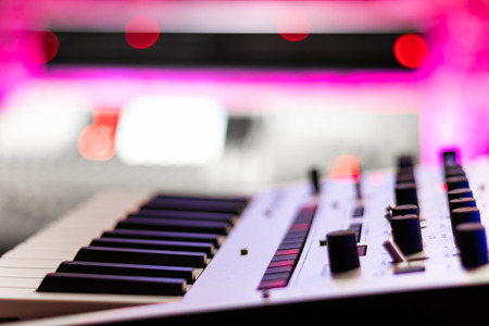 music keyboard synthesizer in studio, shallow dept of field. music background