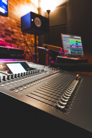 digital mixing console in recording studio. music production and sound engineering concept
