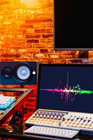 colourful waveform on display in loft interior design digital sound studio for modern home recording, broadcasting, editing studio concept Imagens