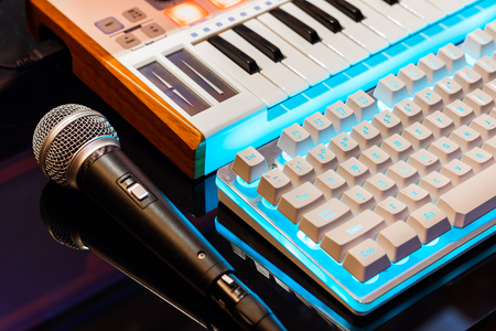 microphone, midi keyboard controller and computer keyboard. home recording studio concept