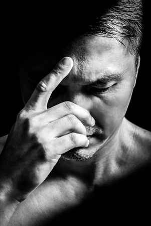 black and white portrait of unhappy asian man, close up