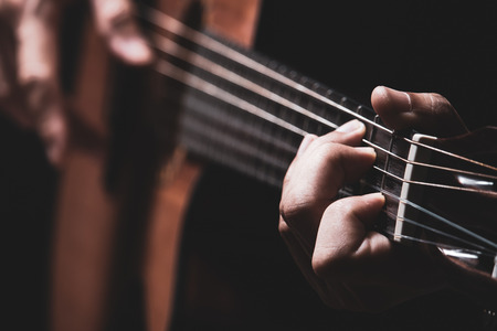 male musician hands playing acoustic guitar Stockfoto