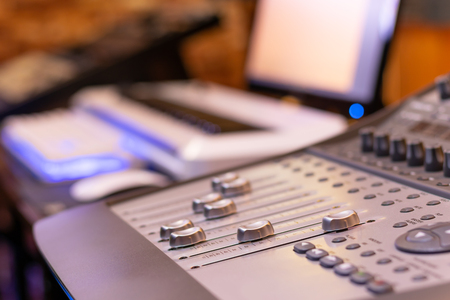 digital mixing console in home recording studio, post production, editing, broadcasting concept