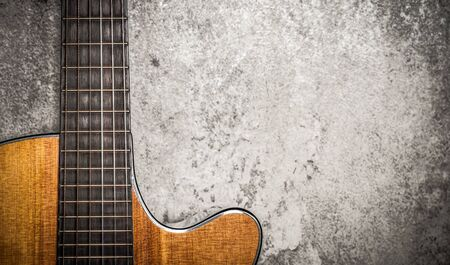 acoustic guitar on cement wall background Stockfoto