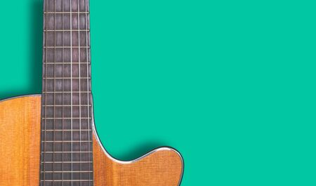 acoustic guitar on green wall background Stockfoto