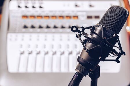 condenser microphone on audio mixing board background Stockfoto