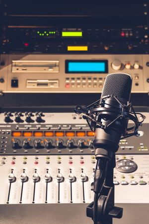condenser microphone on audio mixing console and professional recording studio equipment background Stockfoto